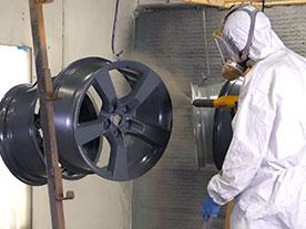Person powder coating on rim